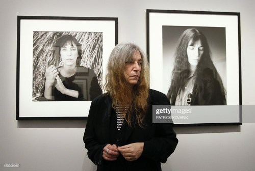 US singer and songwriter Patti Smith poses during the opening of an exhibition dedicated to the late US photographer Robert Mapplethorpe at the Grand Palais in Paris on March 24, 2014. AFP PHOTO / PATRICK KOVARIK RESTRICTED TO EDITORIAL USE, MANDATORY MENTION OF THE ARTIST UPON PUBLICATION, TO ILLUSTRATE THE EVENT AS SPECIFIED IN THE CAPTION (Photo credit should read PATRICK KOVARIK/AFP/Getty Images)