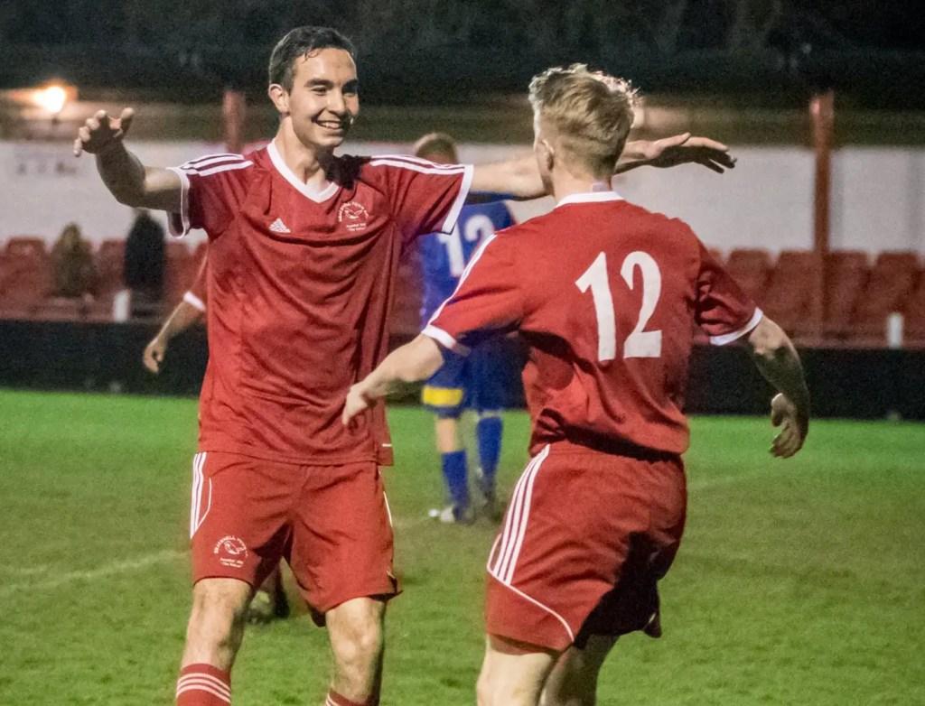 Ben Poynter celebrates scoring with Sean Hanley. Photo: Neil Graham.