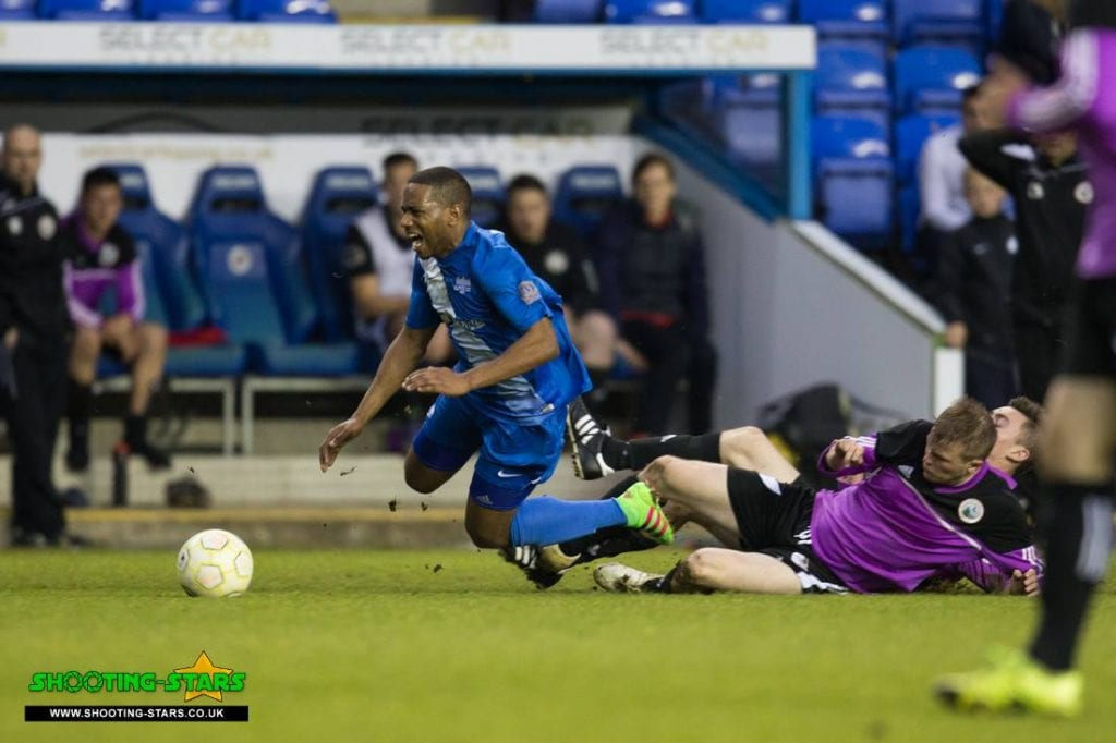 Jemel Johnson is fouled in the Reading Senior Cup Final. Photo: Rob Mack.