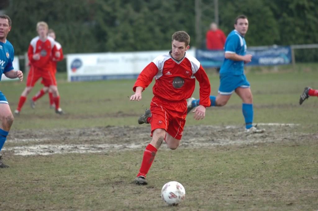 Ben Edwards plays on a muddy Larges Lane surface.