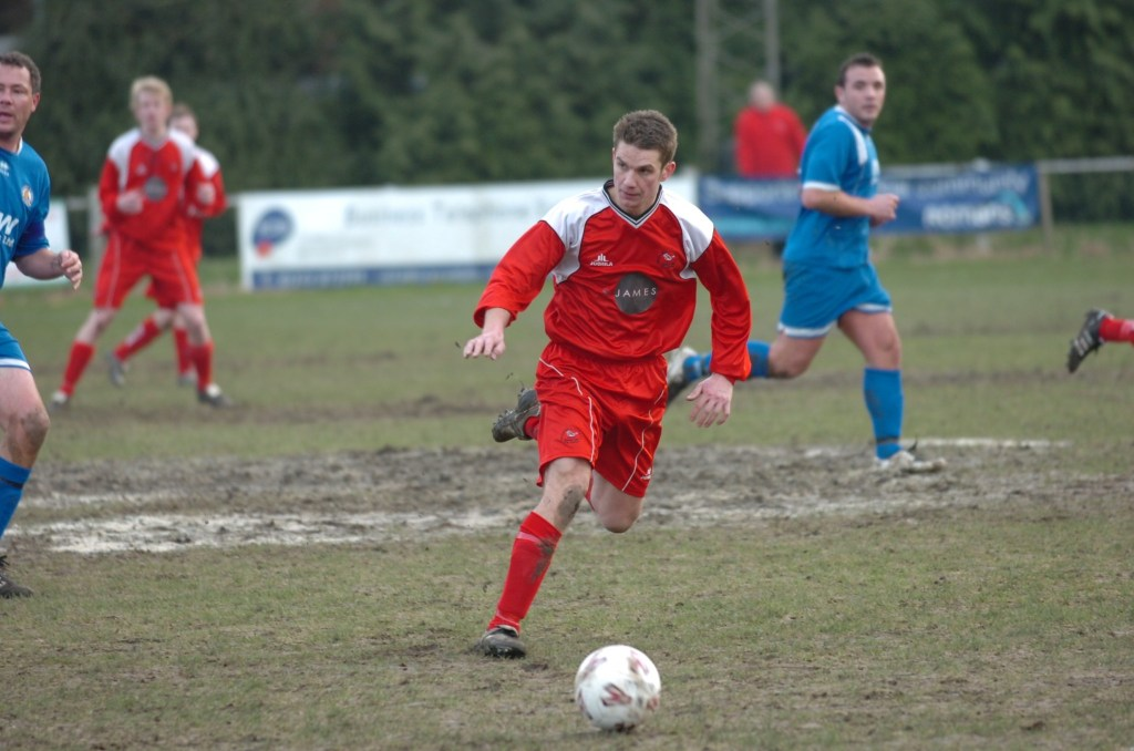 Ben Edwards plays on a muddy Larges Lane surface.