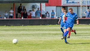 TJ Bohane takes a penalty for Highworth Town. Photo: Neil Graham.