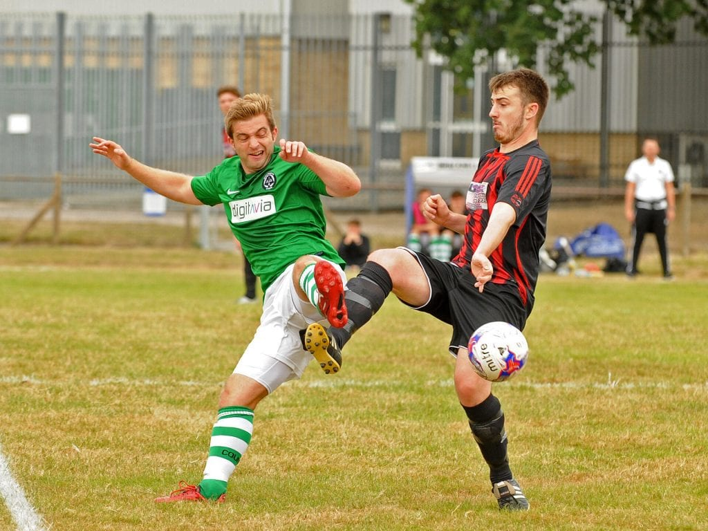 Sam Dennison challenges for Berks County FC. Photo: Mark Pugh.