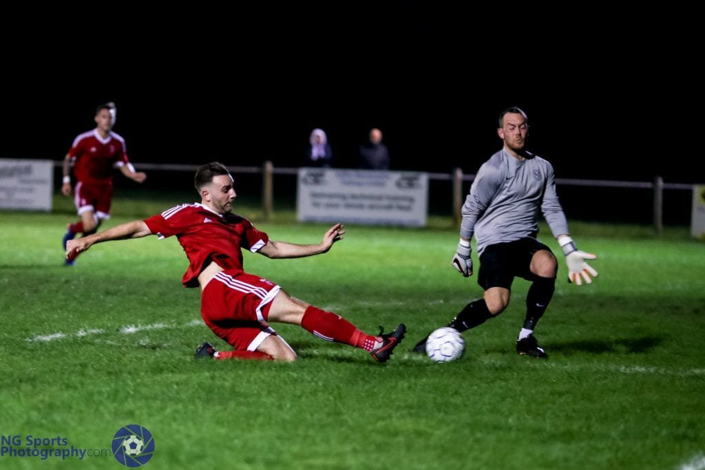 Adam Cornell scores for Bracknell Town FC against Thatcham Town. Photo: Neil Graham.