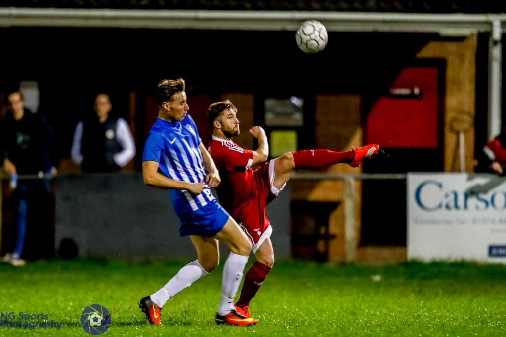 John Gray stretches for Bracknell Town FC. Photo: Neil Graham.