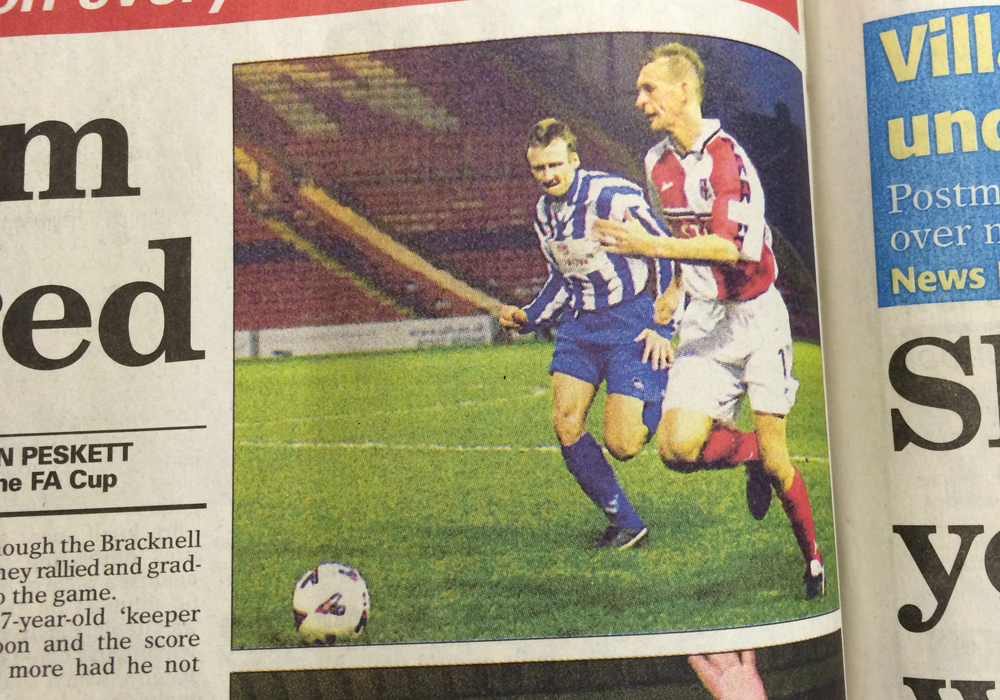 Mark Franks pictured in the Wokingham Times for Bracknell Town (blue) against Lincoln City.