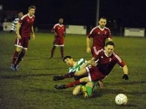 Bracknell Town's Joe Grant takes a tumble against Thame United. Photo: Mark Pugh.