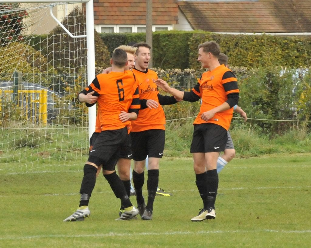 Wokingham & Emmbrook celebrate Jack Gibbs goal. Photo: Mark Pugh.