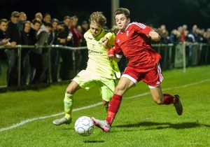 George Lock competes for the ball against Bracknell Town's Seb Bowerman. Photo: Colin Byers.