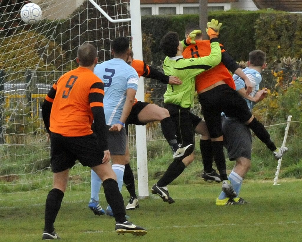 Wokingham & Emmbrook's third goal against Woodley United. Photo: Mark Pugh.