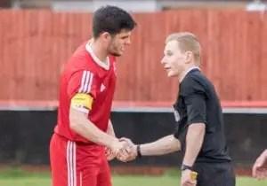 Lee Rushe captains Bracknell Town FC against Royal Wootton Bassett Town. Photo: Neil Graham.