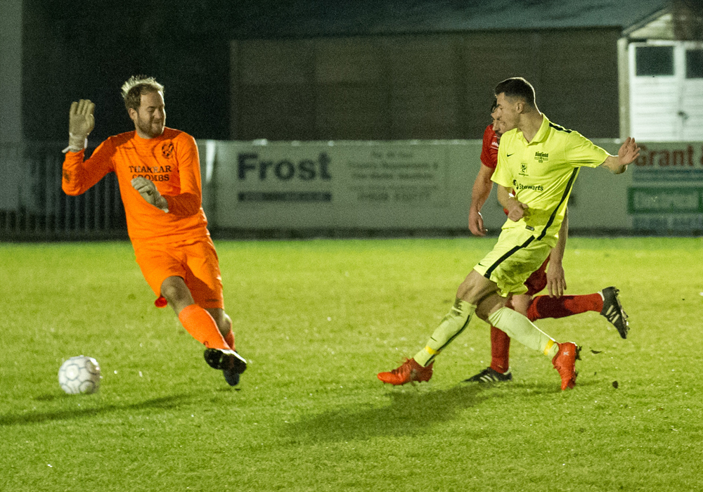 Luke Hayden scores for Binfield FC against Flackwell Heath. Photo: Colin Byers.
