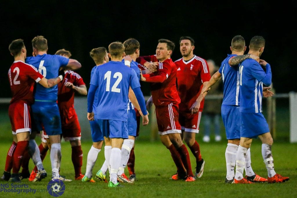 Melee in the middle that saw Callum Willmoth sent off for Thatcham Town FC. Photo: Neil Graham.