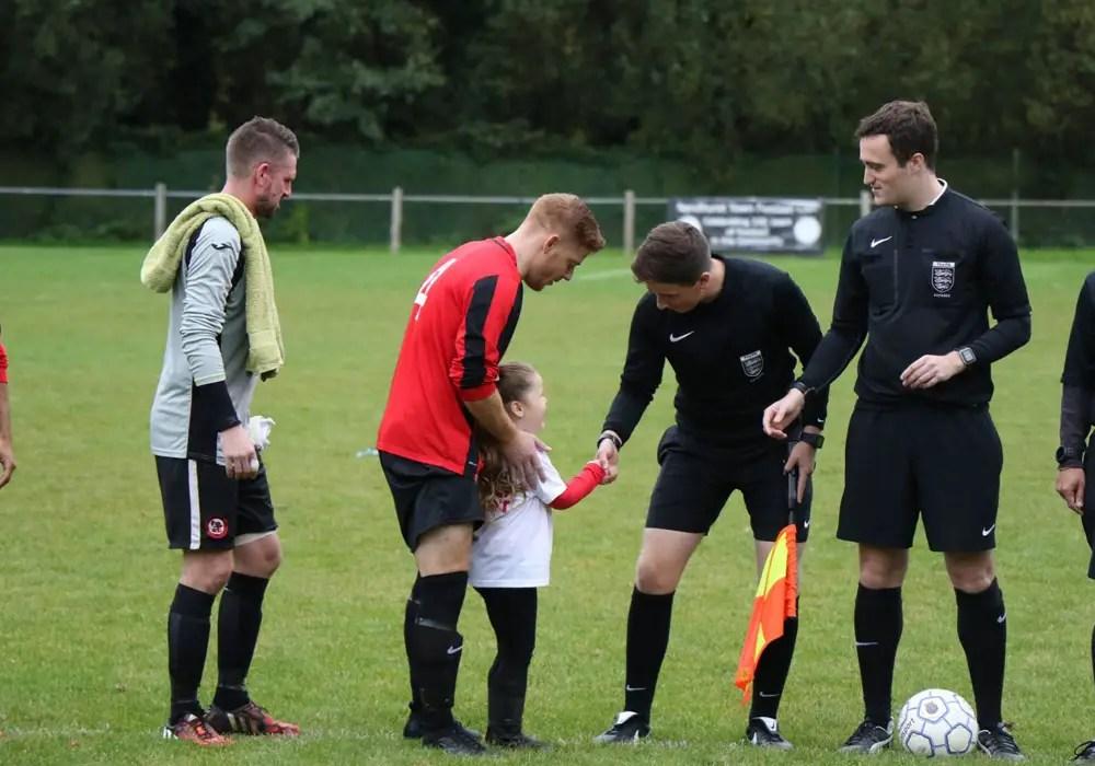 Ollie Kaya meeting a mascot before the Sandhurst Town vs Bicester Town fixture. Photo: Richard Milam.