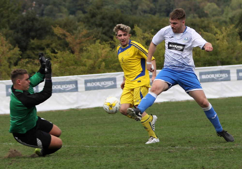 Cameron Miller scoring for Eversley & California FC. Photo: Richard Milam.