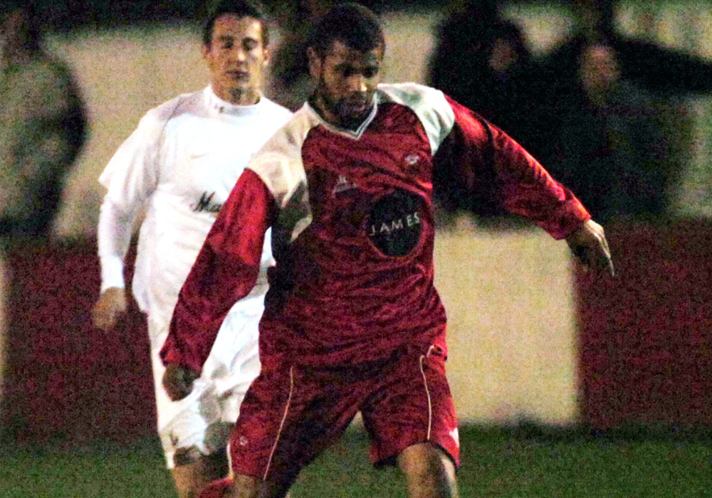 Errol Telemaque playing for Bracknell Town against MK Dons. Photo: Get Reading.
