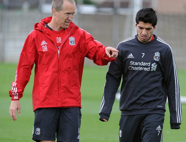 Darren Burgess with Luis Suarez on August 9, 2011 in Liverpool, England.