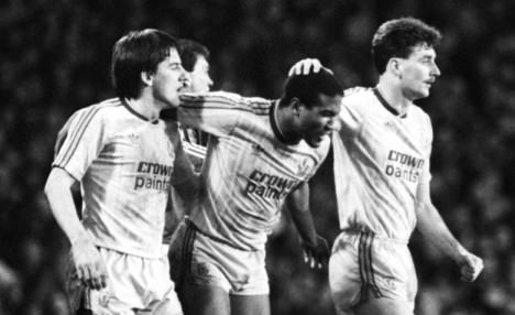 Liverpool's John Barnes (c) celebrates scoring his team's second goal with teammates Peter Beardsley (l) and John Aldridge (r)