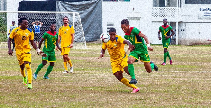 A football game being played in the fields of French Guiana