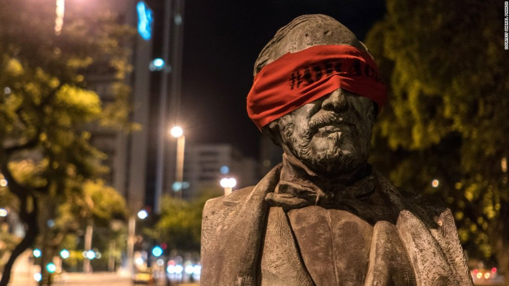 Shielding the eyes of the powerless: During the 2014 protests in Brazil, an artist blindfolded all the statues in Rio in a silent demonstration against the country's politicians.