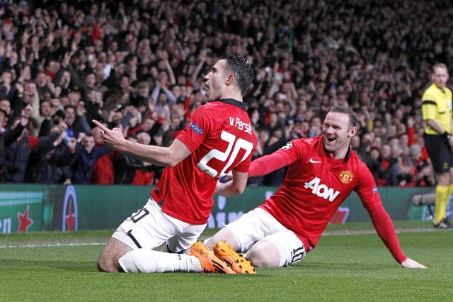 Robin van Persie (right) celebrates scoring their third goal
