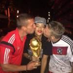 Rihanna holding World Cup trophy with Gotze & Podolski