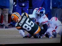 C. You can see the shin contacting the ground before the knee, but the ball is obscured.