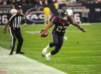 Line judge Gary Arthur has his eyes on the feet of Texans running back Arian Foster. (Houston Texans photo)