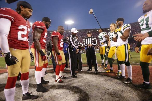 Referee Jerome Boger shows the coin to the Packers captains. (San Francisco 49ers photo)