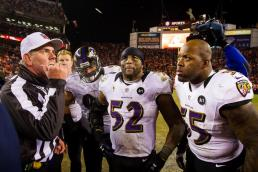 Area 52: Referee Bill Vinovich (uniform number 52) flips the coin for overtime, as Ravens retiring linebacker Ray Lewis (52) looks on. (Baltimore Ravens photo)