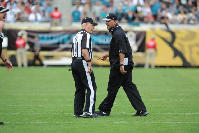 Retiring side judge Dave Wyant discusses a call this season with Jaguars coach GusBradley [Jacksonville Jaguars photo].