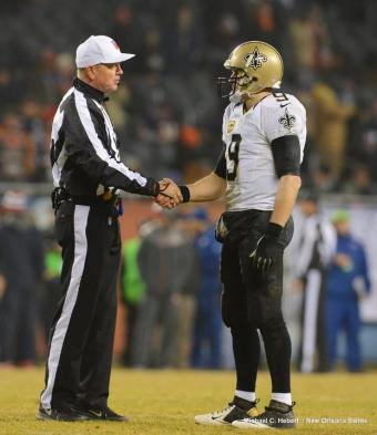 Referee Carl Cheffers greets Drew Brees (New Orleans Saints photo)