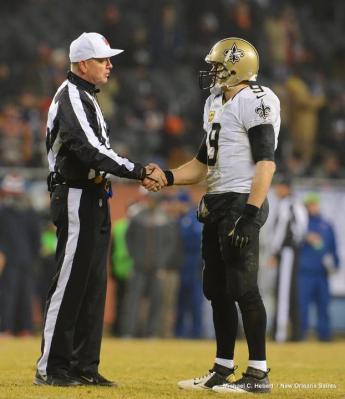 Referee Carl Cheffers greets Drew Brees (New Orleans Saints photo)