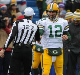 Referee Bill Leavy greets Aaron Rodgers (Green Bay Packers photo)