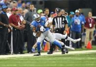 Jeff Bergman taking mental snapshots of the play (Detroit Lions)