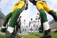 Carl Cheffers tosses the coin (Detroit Lions)