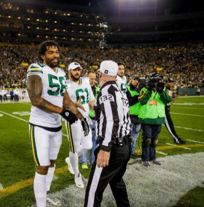 John Parry greets the Packers' captains (Green Bay Packers)