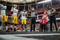 Walt Anderson tosses the coin (Green Bay Packers)