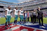 Bill Vinovich has a special guest toss the coin (Philadelphia Eagles)