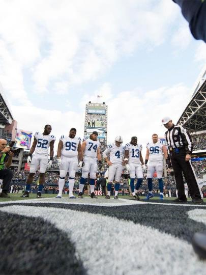 Referee Brad Allen conducts the coin toss (Indianapolis Colts)