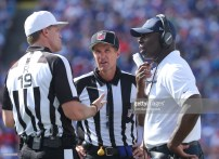 Referee Clay Martin and down judge Kent Payne (Photo by Tom Szczerbowski/Getty Images)