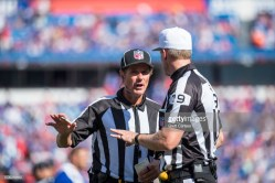 Referee Clay Martin and down judge Kent Payne (Photo by Brett Carlsen/Getty Images)