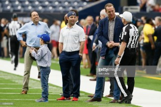 HOUSTON, TX - SEPTEMBER 23: Peyton Manning and referee Walt Coleman #65 shake hands before the game between the Houston Texans vs New York Giants at NRG Stadium on September 23, 2018 in Houston, Texas. (Photo by Bob Levey/Getty Images)