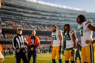 Referee John Hussey tosses the coin (Green Bay Packers)