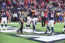 Back judge Steve Patrick. Mark Perlman is signalling the touchdown. (Houston Texans)