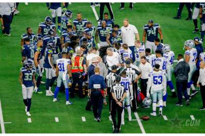 Gary Arthur, Terry Brown and Carl Paganelli during an injury timeout (Dallas Cowboys).