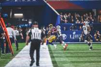 Jeff Bergman with an out of focus Steve Zimmer (Los Angeles Rams)