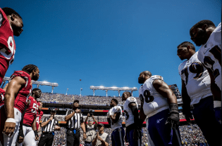 Ron Torbert conducts the coin toss. (Baltimore Ravens)