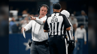 Down judge Tom Stephan. Referee Walt Anderson partially obscured. (Dallas Cowboys)