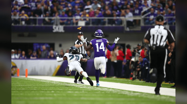 Chad Hill calls a foul with Derek Bowers in the foreground (Minnesota Vikings)